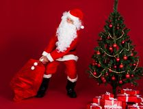 Santa pulling gifts sack Stock Photo