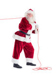 Santa pulls something with a rope Stock Image