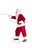 Santa pulls something with a rope Stock Photo