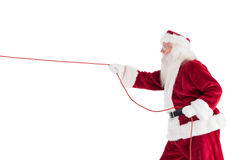 Santa pulls something with a rope Stock Photos