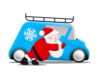 Santa pushing a blue mini car Royalty Free Stock Images