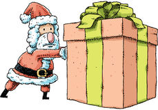 Santa Pushing Present Royalty Free Stock Photo
