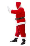 Santa pushing something Royalty Free Stock Photography