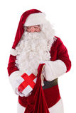 Santa put the box in the bag Royalty Free Stock Photo