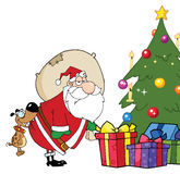 Santa put gifts under the christmas tree Stock Images