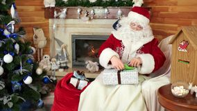 Santa put presents in his sack, saint nicolas pack presents due to kids letters, santa claus mail stock video