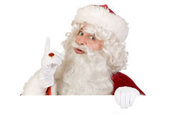 Santa putting finger up Royalty Free Stock Photography