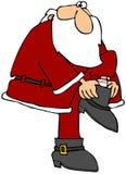 Santa Putting On His Boot Stock Image