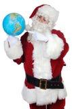 Santa que aponta em um globo Imagens de Stock Royalty Free