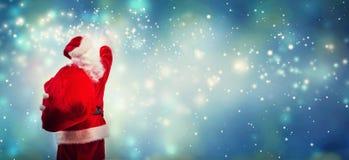 Santa que aponta no céu imagens de stock