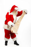 Santa que controla su lista Fotografía de archivo libre de regalías