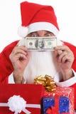 Santa que dá o presente do dinheiro   fotografia de stock royalty free