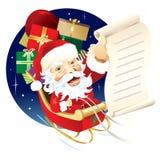 Santa que entrega los regalos de la Navidad Imagen de archivo