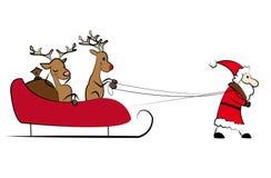 Santa que puxa o trenó do Natal Fotografia de Stock Royalty Free