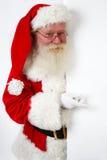 Santa que señala en la bandera Fotos de archivo libres de regalías