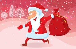 Santa que se ejecuta Imagen de archivo libre de regalías