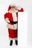 Santa que se inclina en bandera Fotografía de archivo