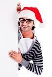 Santa que señala abajo en la cartelera en blanco Fotos de archivo libres de regalías