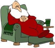 Santa que toma una siesta Foto de archivo libre de regalías