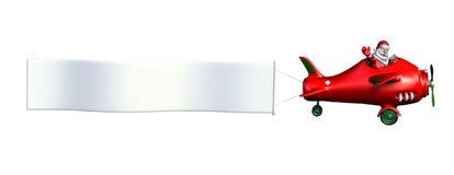 Santa que vuela un plano con la bandera Fotos de archivo libres de regalías