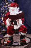 Santa Reading. Book, cover blank and fully editable to put what you want it to say stock photo