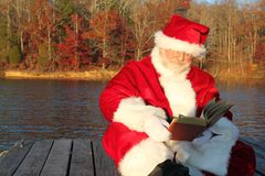 Santa Reading on the Dock Stock Images