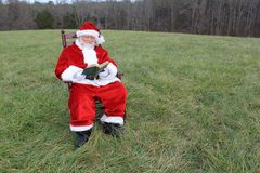 Santa Reading In the Field 2 Royalty Free Stock Images