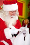 Santa reading a letter Royalty Free Stock Image