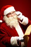 Santa reading letter Stock Photos