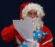 Santa reading a list Royalty Free Stock Images