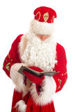 Santa reading list of gifts. Stock Image