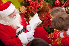 Santa reading to the kids Stock Photo