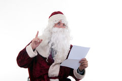 Santa reads the letter Royalty Free Stock Photography