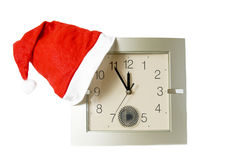 Santa red cap on clock Stock Images