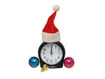 Santa red cap on clock.Isolated. Royalty Free Stock Photos
