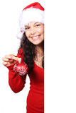 Santa with red christmas bauble. Cute Santa with red christmas bauble behind white board Royalty Free Stock Images