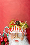 Santa on red with Christmas ornaments Royalty Free Stock Images