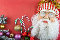 Santa on red with Christmas ornaments Royalty Free Stock Photos