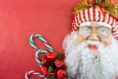 Santa on red with Christmas ornaments Stock Photography