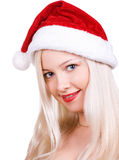 Santa in red hat. The girl the blonde in hat Santa smiles Stock Image