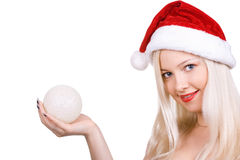 Santa in a red hat with a sphere. The girl in a hat santa stretches a sphere in a hand Stock Photo