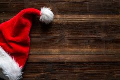 Santa red hat on wooden background, holiday Christmas concept royalty free stock photo