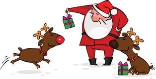 Santa and reindeer. Santa gives Christmas gifts to his reindeer Stock Photo