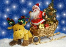 Santa with reindeer. Reindeer is pulling golden sleigh with Santa, gifts and christmas tree Stock Images