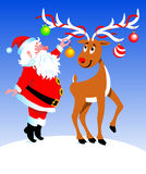 Santa and reindeer. Santa Claus is decorating his reindeer Royalty Free Stock Photography