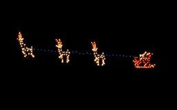 Santa and Reindeer. Christmas lights of Santa and his Reindeer Royalty Free Stock Photos
