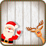 Santa and reindeer in christmas frame Royalty Free Stock Photos