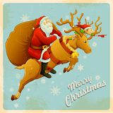 Santa on reindeer with Christmas gift Stock Images