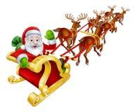 Santa and Reindeer Christmas Sleigh Stock Images