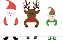 Santa, Reindeer and elf holding Sign. Santa Claus , Reindeer and an elf holding a plan, simple sign Royalty Free Stock Photography